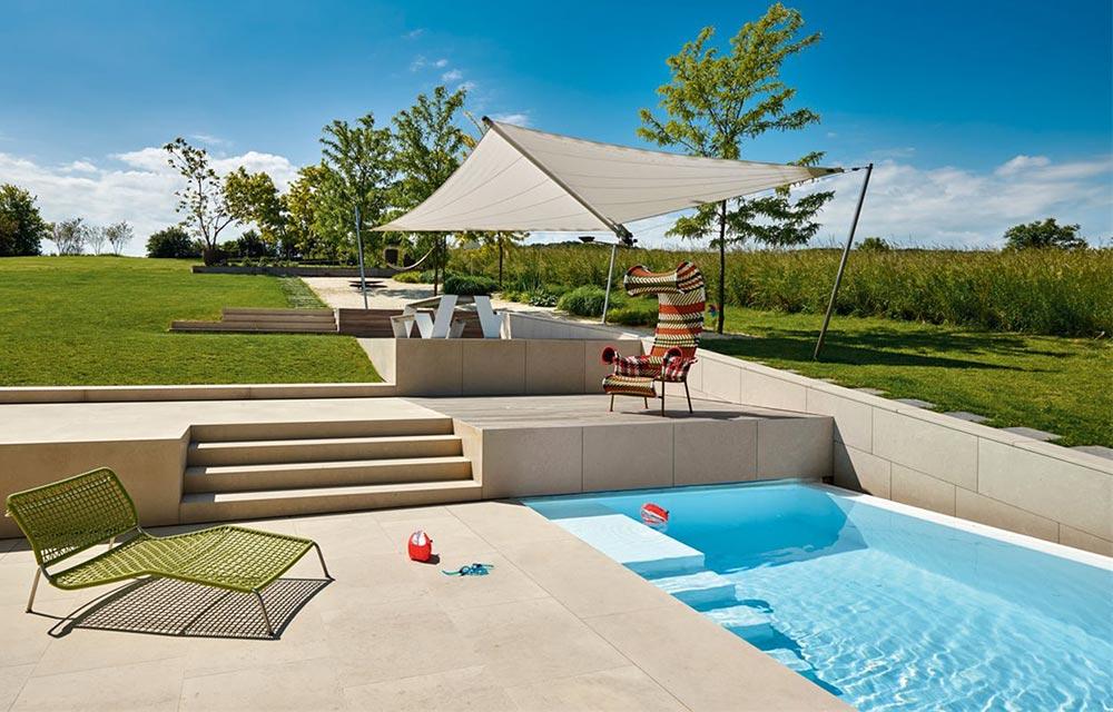 Come costruire una piscina interrata nel proprio giardino